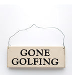 wood sign saying Gone Golfing