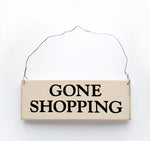 wood sign saying Gone Shopping