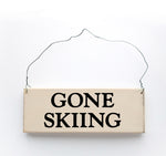 wood sign saying Gone Skiing