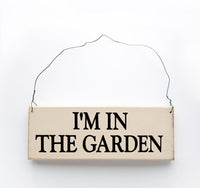 wood sign saying I'm in the Garden