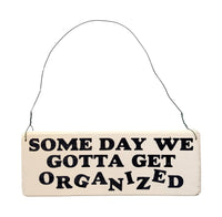 wood sign saying Some Day We Gotta Get Organized