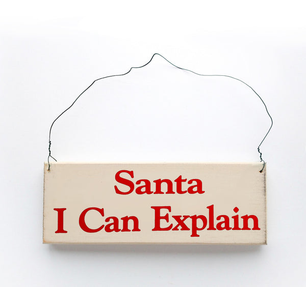 wood sign saying Santa I Can Explain