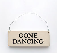 wood sign saying Gone Dancing