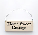 wood sign saying Home Sweet Cottage
