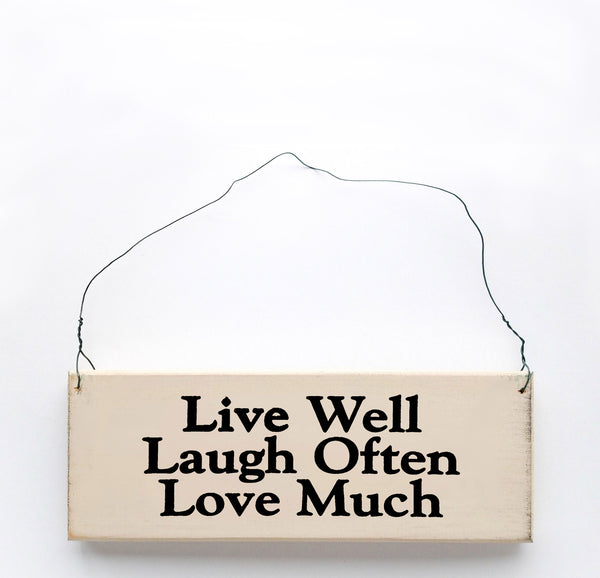 wood sign saying Live Well, Laugh Often, Love Much