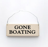 wood sign saying Gone Boating