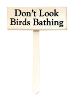 wood sign saying Don't Look Birds Bathing