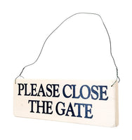 wood sign saying Please Close the Gate