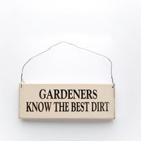 wood sign saying Gardeners Know The Best Dirt
