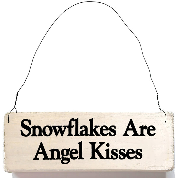 wood sign saying Snowflakes Are Angel Kisses