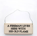 wood sign saying A Fireman Lives Here With His Old Flame