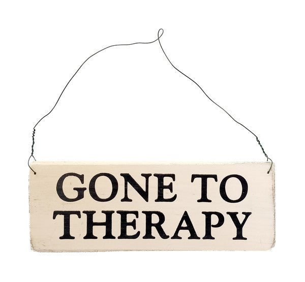 wood sign saying Gone To Therapy