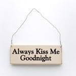 wood sign saying Always Kiss Me Goodnight