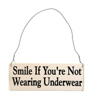 wood sign saying Smile if You're Not Wearing Underwear