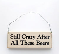 wood sign saying Still Crazy After All These Beers