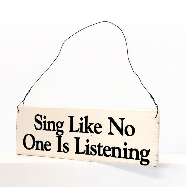 wood sign saying Sing Like No One is Listening