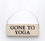 wood sign saying Gone To Yoga