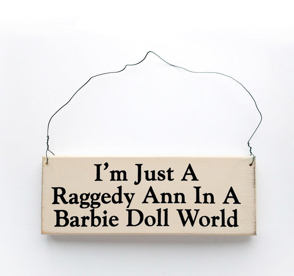 wood sign saying I'm Just A Raggedy Ann In A Barbie Doll World