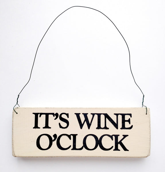 wood sign saying It's Wine O' Clock
