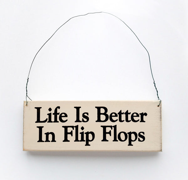 wood sign saying Life Is Better In Flip Flops