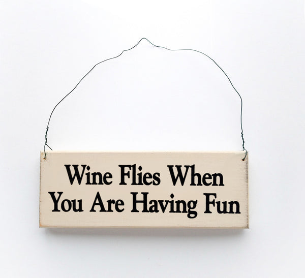 wood sign saying Wine Flies When You Are Having Fun