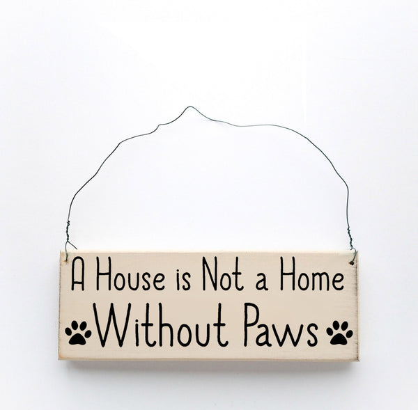 wood sign saying A House is Not A Home Without Paws