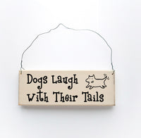 wood sign saying Dogs Laugh With Their Tails
