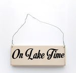 wood sign saying On Lake Time