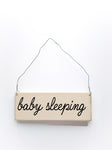 wood sign saying Baby Sleeping