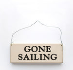 wood sign saying Gone Sailing