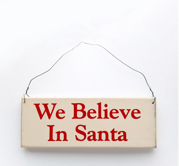 wood sign saying We Believe in Santa