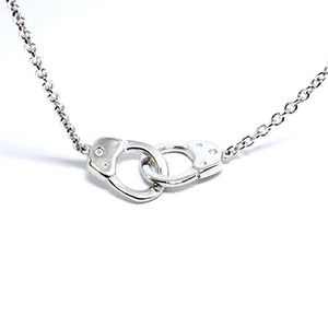 "THE STERLING SILVER ""PARTNERS IN CRIME"" NECKLACE"