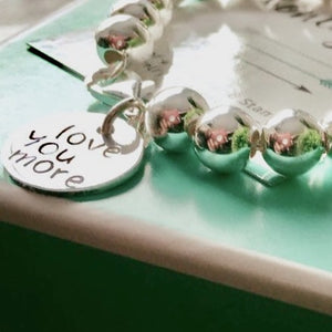 "8mm Sterling Silver ""Love You More"" ball bracelet"