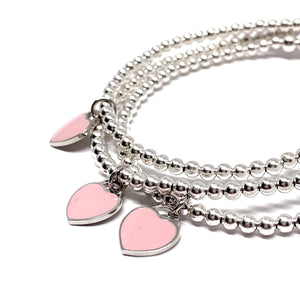 "THE ""FOREVER"" STERLING SILVER HEART BRACELET (PINK)"