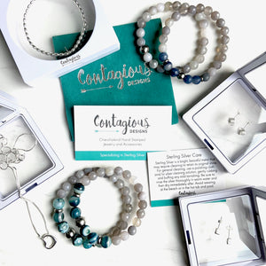 "THE CONTAGIOUS DESIGNS ""SURPRISE"" GIFT BUNDLE"