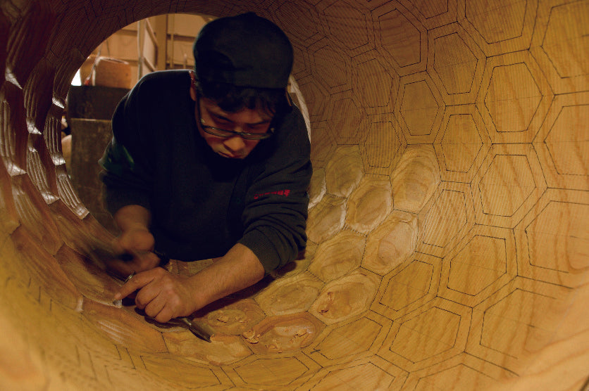 Asano craftsmen carves hexagonal kikkobori patterns inside of a nagado