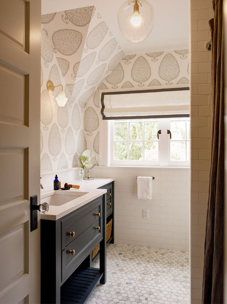 Bathroom with black cabinet, Katie Ridder wallpaper and Cumberland Sconce