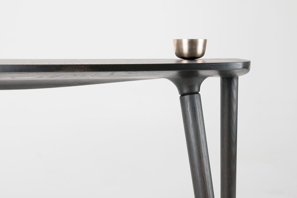 Bristol Console Table in Seasoned Black detail shot of top with a silver cup by Studio DUNN