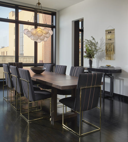 Black and white dining room with gold details by Studio Gild, photographed by Mike Schwartz