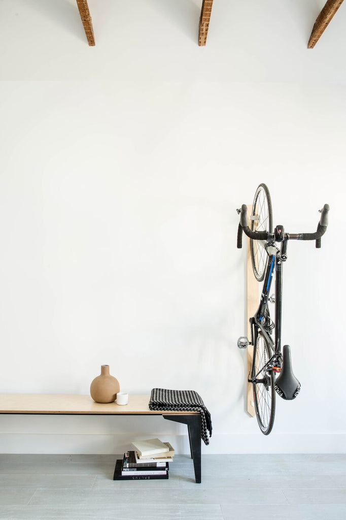 Entryway with bike hanging on wall designed by Geremia Design with photo by Aubrie Pick