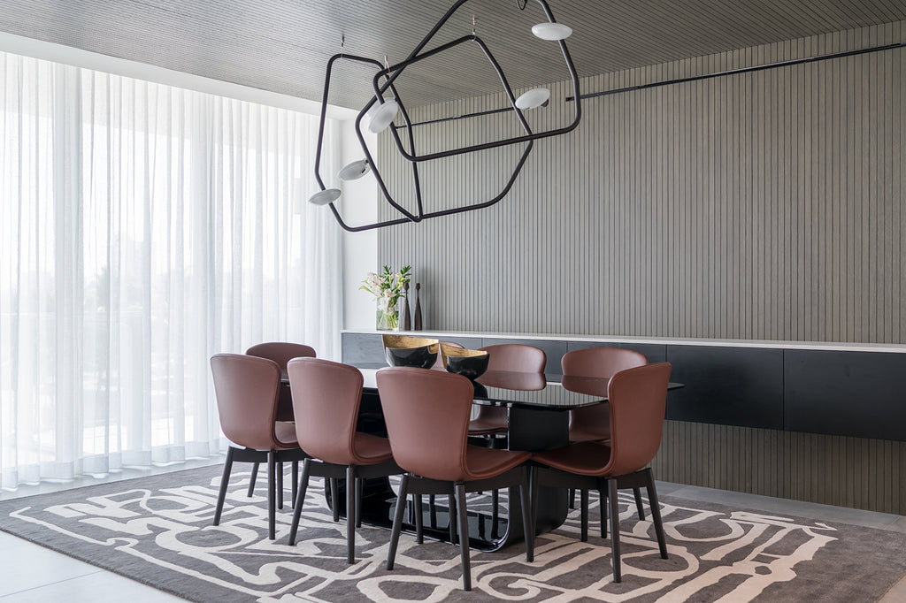 Dining Room by IG Workshop with rug by Art + Loom