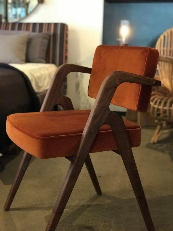 Modern chair with reddish upholstery