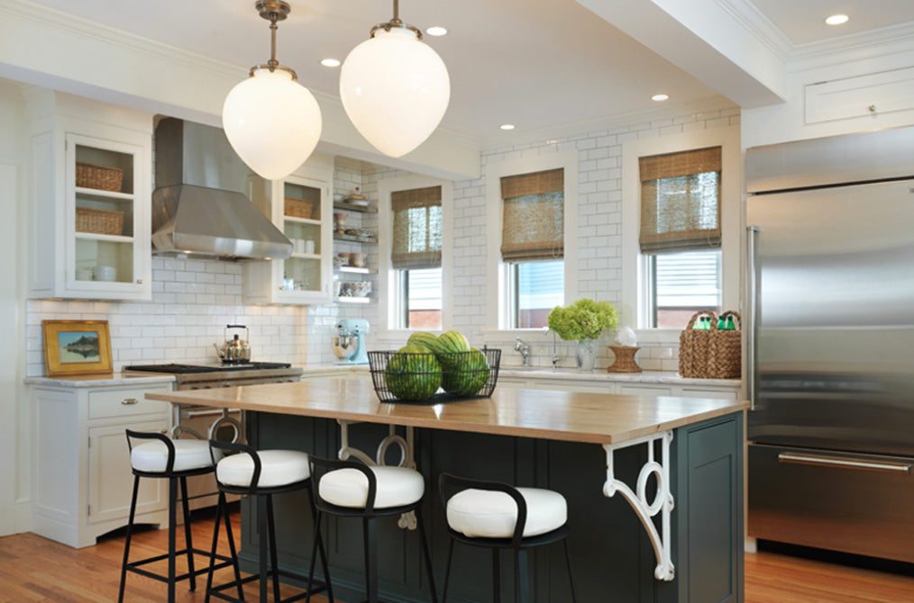 Kitchen with black and white stools and large globe light fixtures