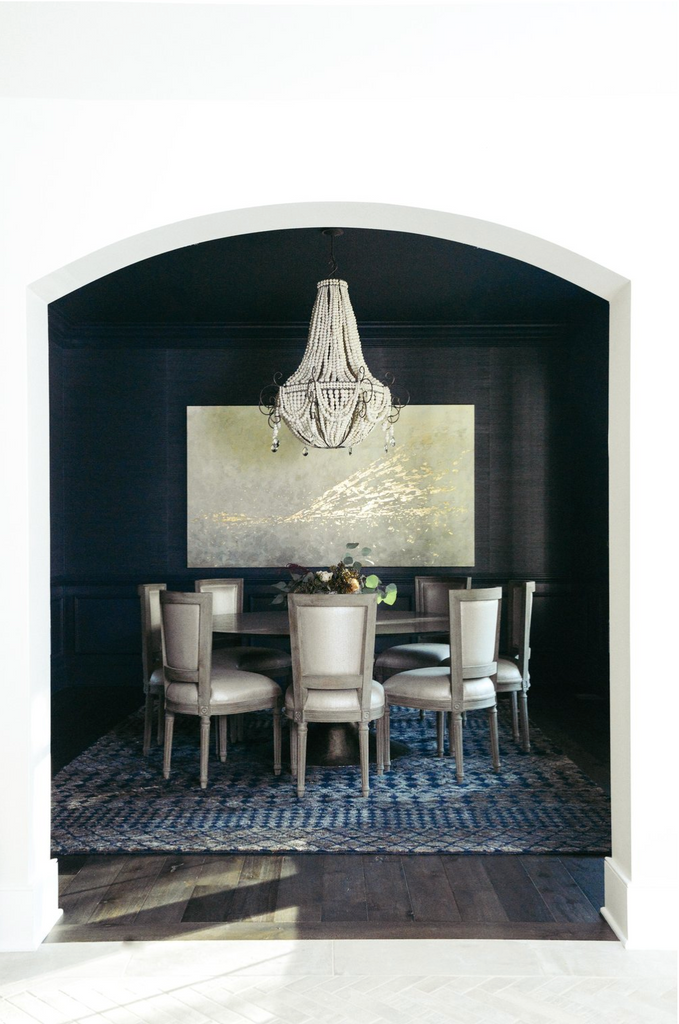 Dark Dining Room with statement chandelier by Haus Love Interiors