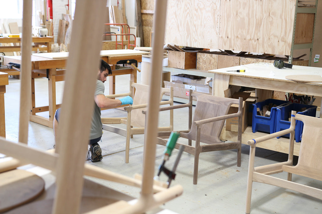 Studio DUNN production team member working on Stillwater Club Chairs