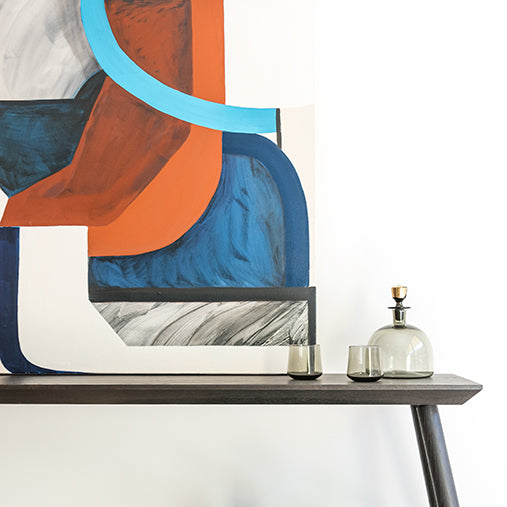 Close up of Studio DUNN Rockport Console with original artwork in a project by Geremia design with photo by Stephanie Russo