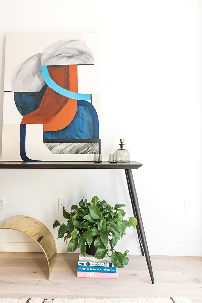 Entryway designed by Geremia Design with original artwork and Rockport Console Table by DUNN