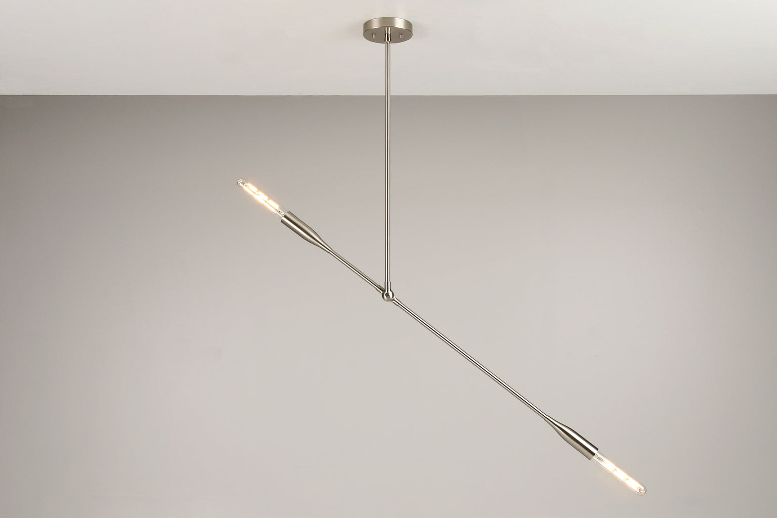 Contemporary Sorenthia Light fixture in Brushed Nickel by Studio DUNN with a grey wall background and white ceiling