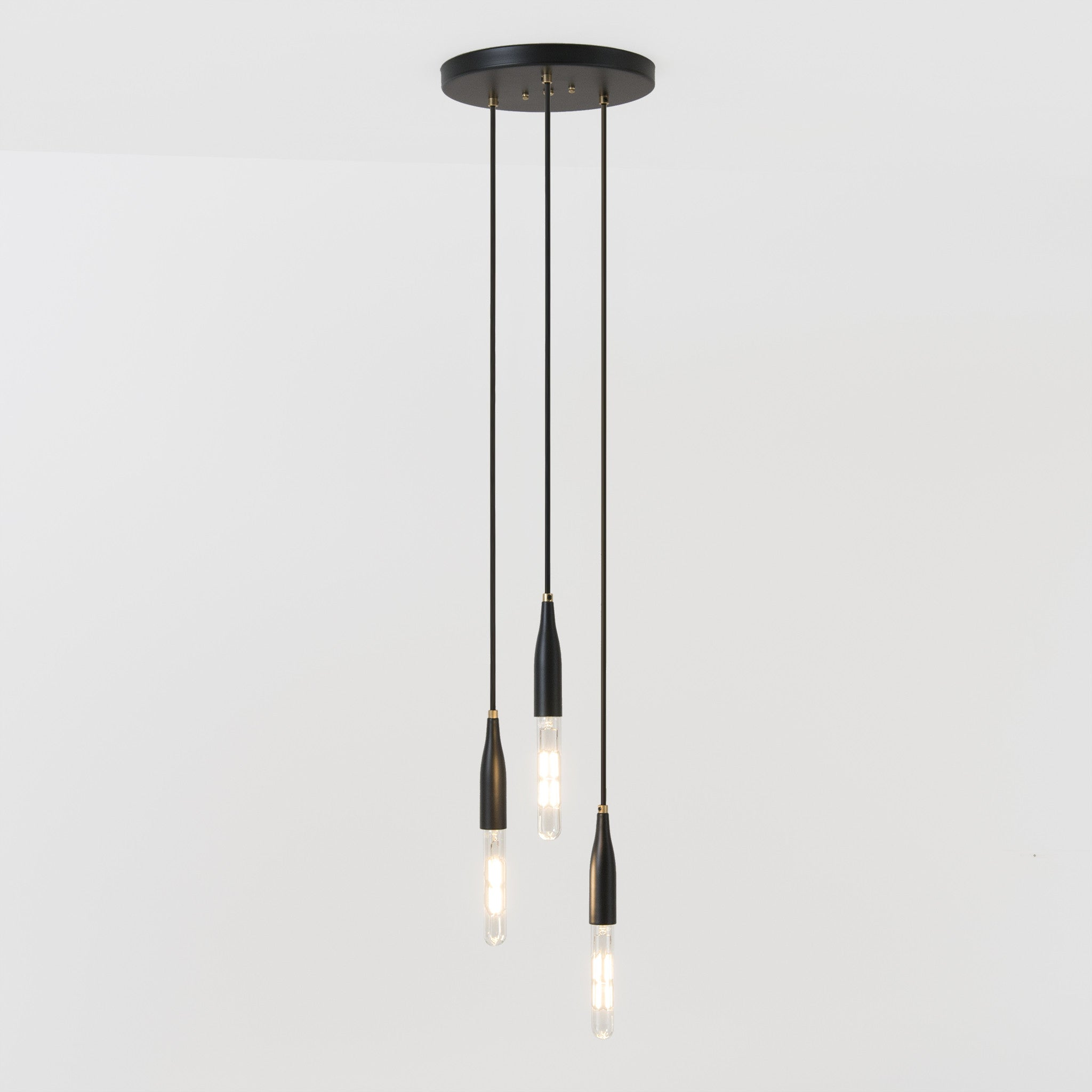 Studio DUNN's Flute collection minimalist chandelier in black poppy powder coat with brass details