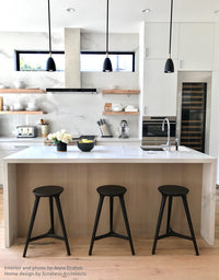 Kingstown Counter Stool in Seasoned Black by Studio DUNN at a kitchen island in an interior by Anna Drabek